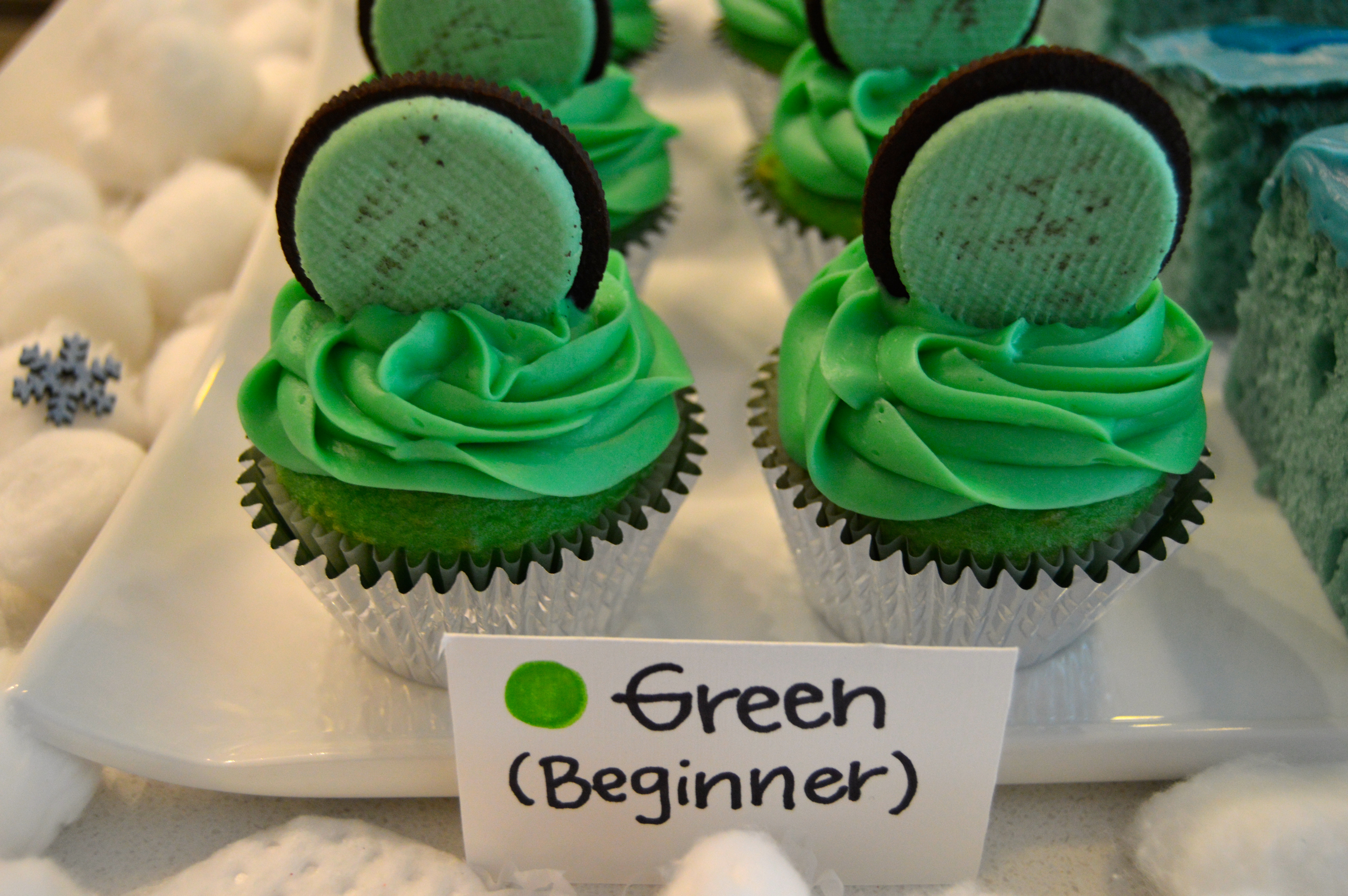 Ski themed party food: Beginner Slope/Green Circle (green cupcake with mint oreo)