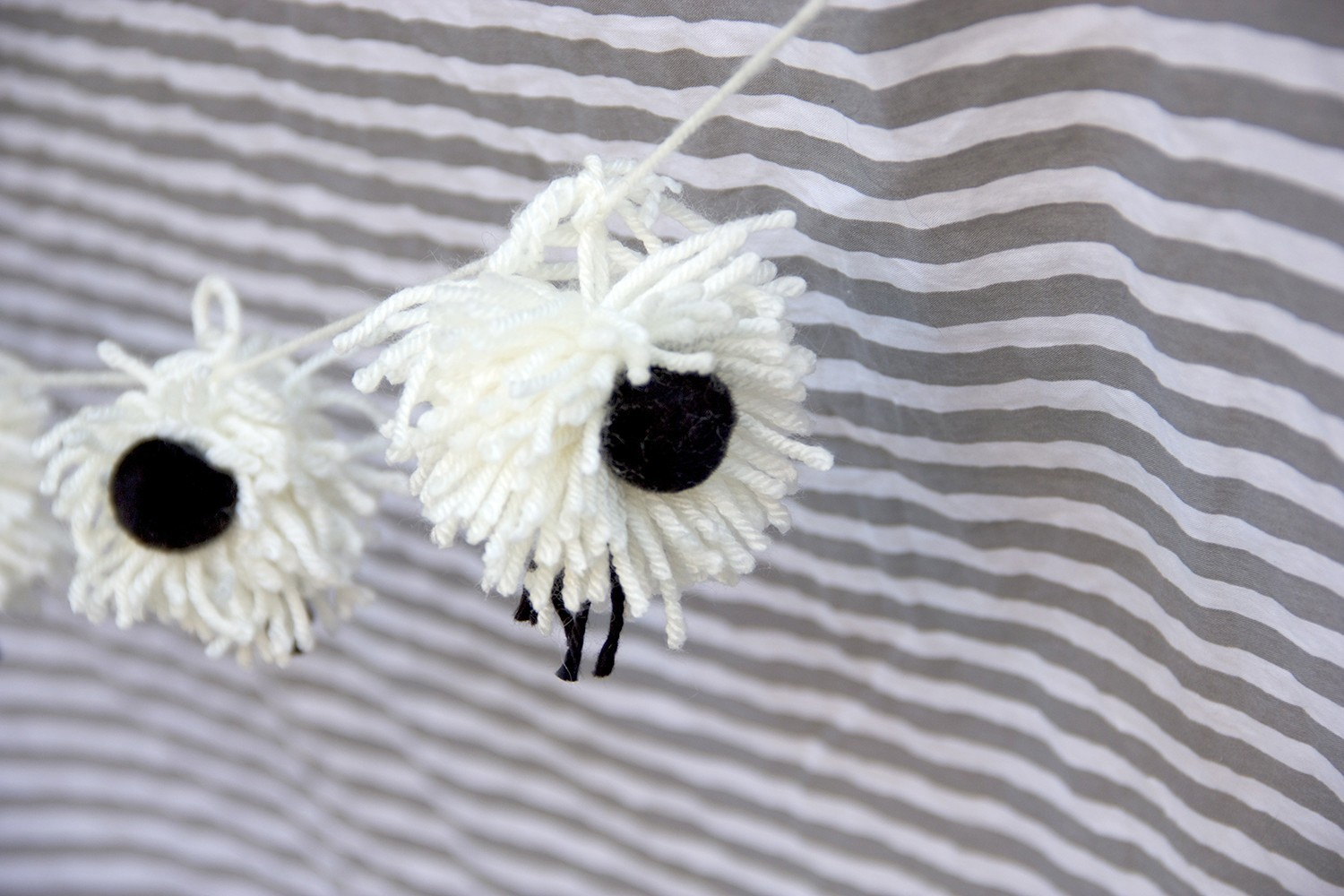 lamb pom pom garland decoration for a lamb themed baby shower