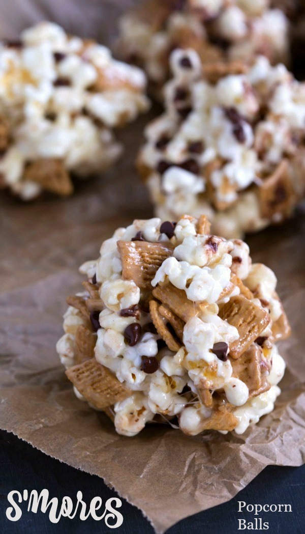 smores-popcorn-balls | A list of the best 25 s'more recipes for summer. Smores dip, cookies, pie, brownies, and other ideas for tasty different ways to make that campfire dessert.