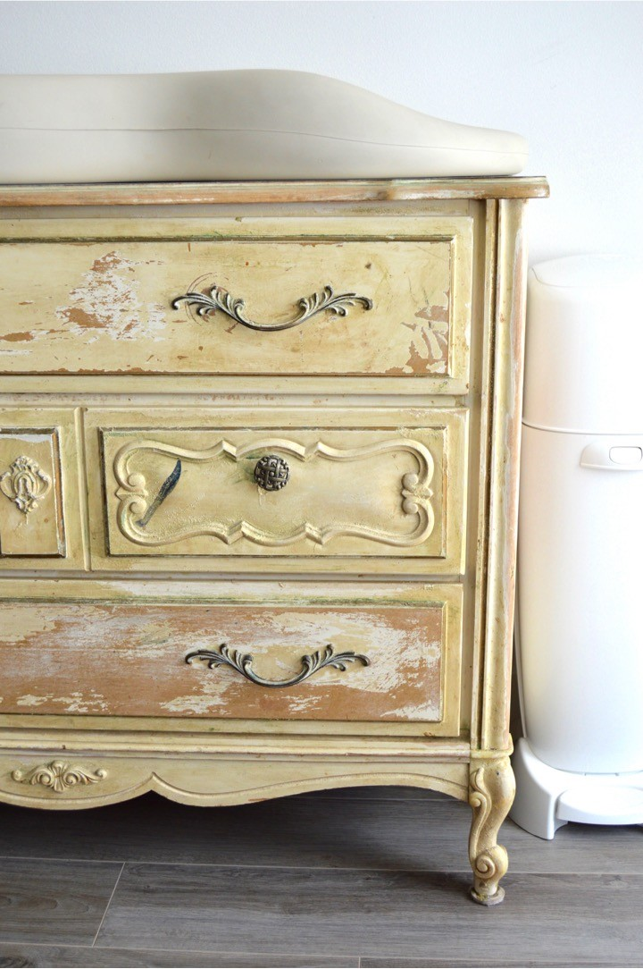 Old dresser repurposed as a baby changing table | Tips for how to make a practical diaper changing station. Changing table ideas like: repurpose a dresser, get a Diaper Genie, buy diapers and wipes in bulk, baby changing pad + more ideas for your baby's nursery. DIY dresser changing table hack. Tips and tricks for when baby comes like where to go shopping for a diaper pail.