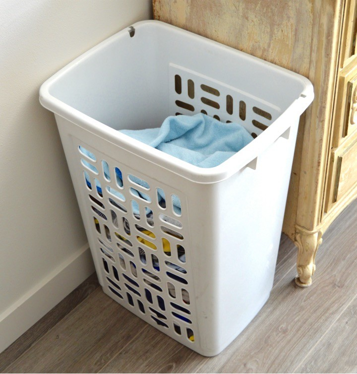 Laundry basket by the changing table | Tips for how to make a practical diaper changing station. Changing table ideas like: repurpose a dresser, get a Diaper Genie, buy diapers and wipes in bulk, baby changing pad + more ideas for your baby's nursery. DIY dresser changing table hack. Tips and tricks for when baby comes like where to go shopping for a diaper pail.