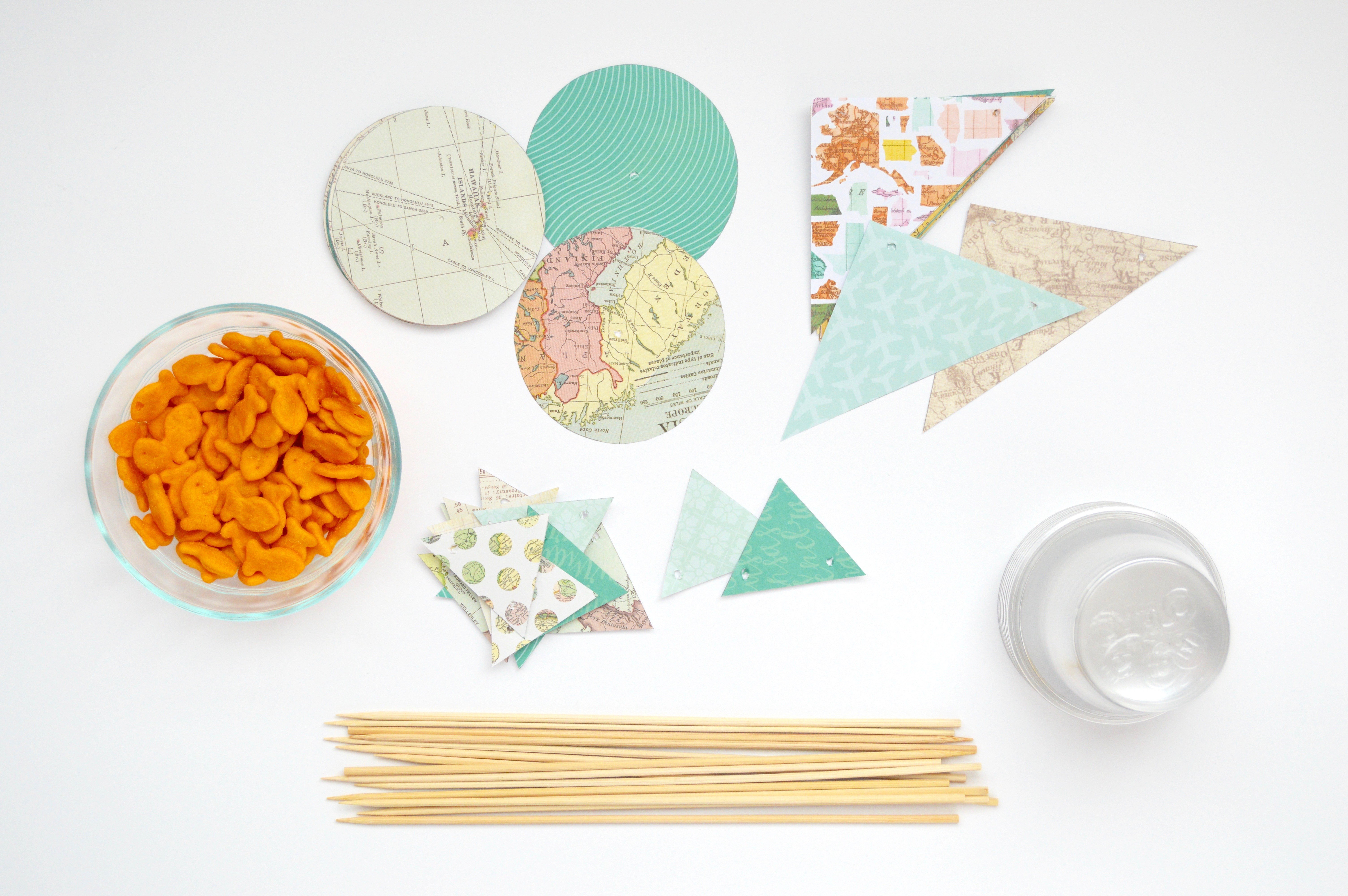 Supplies needed for this craft. Tutorial for how to make Goldfish sailboat party favors for a baby shower, bridal shower, or party. Cute nautical, sailing, travel, + adventure theme ideas.