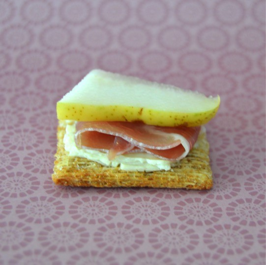 Step 3 - Add pear. Fancy cheese and crackers recipe for the foodie with TRISCUIT Crackers, creamy cheese spread, prosciutto, pear, and arugula leaves. Perfect appetizer or snack. Delicious food to make for a party or just for fun with the kids.