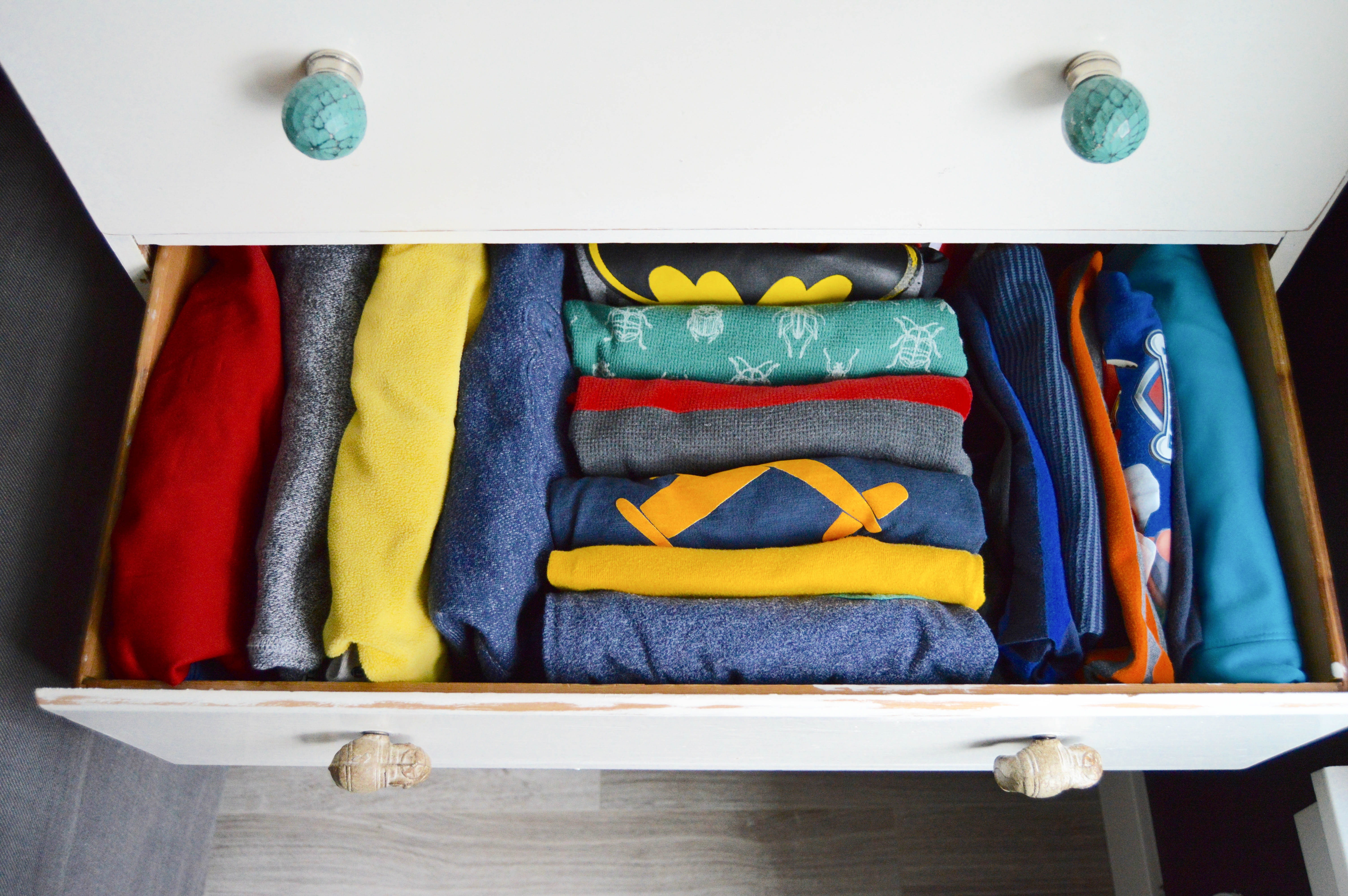 Tips for how to purge and organize your home like a pro. Organizing steps: categorizing and finding homes for things. 5 home organizing rules to live by. Kid clothes in a drawer