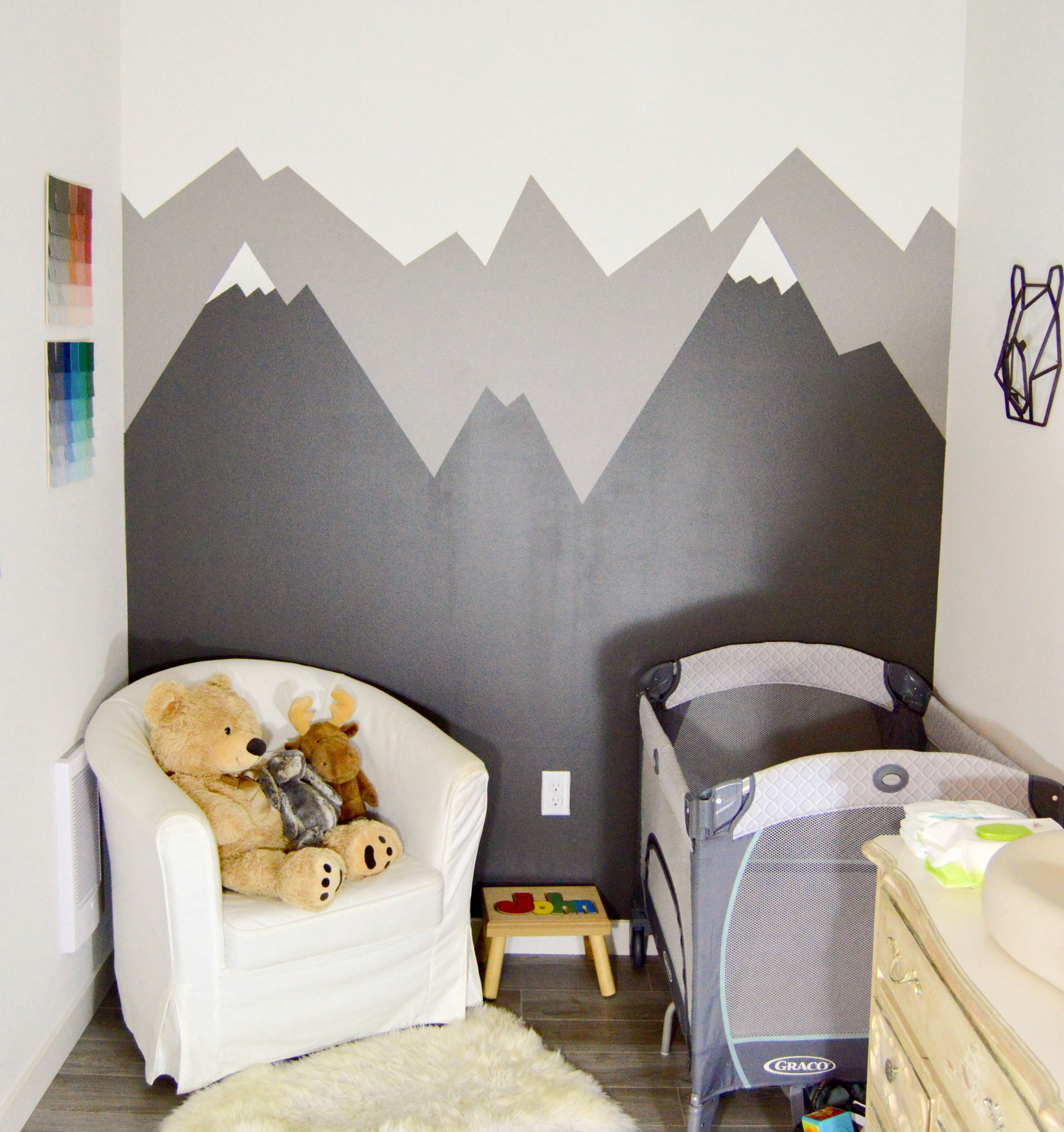 DIY Mountain Wall Mural - Small PNW (Pacific Northwest) outdoor theme nursery with mountains + animals for our baby boy. Mountain mural and paint chip art tutorial for woodland feel.