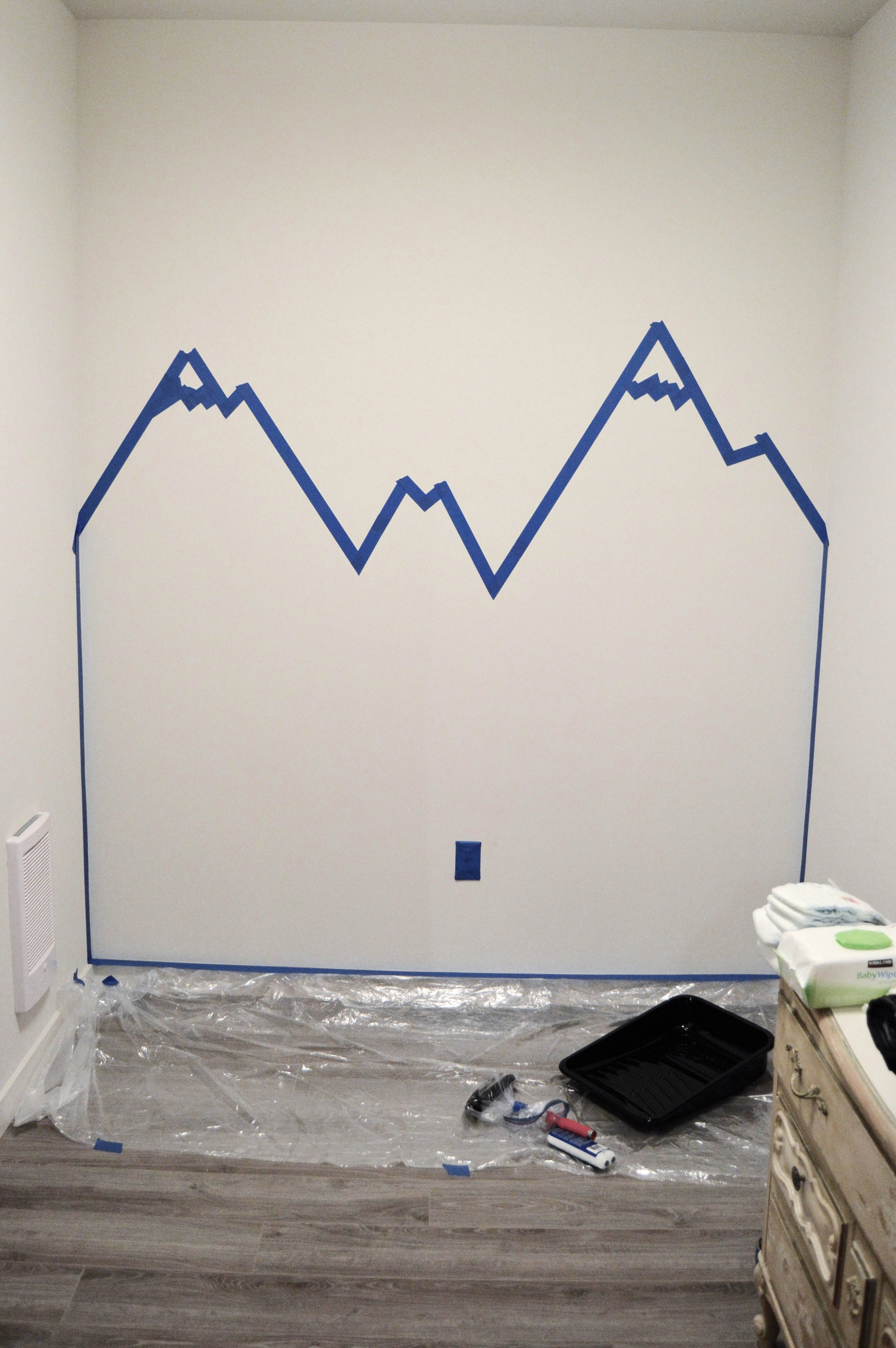 Step 1 Mountain Mural Tutorial - Easy and quick step by step DIY mountain mural tutorial for how to paint a mountain mural on a budget. Cute nursery wall idea for a mountain themed room.